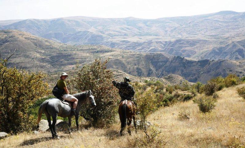 Horse back riders in Khrosov Forest Armenia